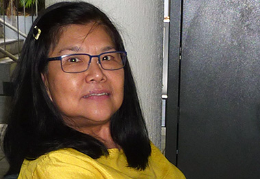 Older woman in yellow top